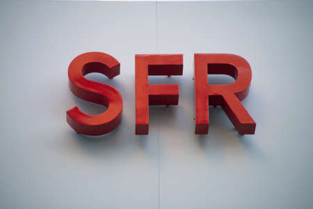 Mulhouse - France - 21 February 2021 - Closeup of SFR logo on phone store front, SFR is the famous french phone operator Redactioneel