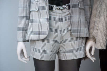 Closeup of classic mini short on mannequin in a fashion store showroom