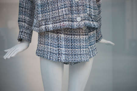 Closeup of classic mini skirt short on mannequin in a fashion store showroom Stockfoto