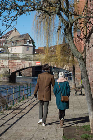 couple walking in border Il river at little France quarter in Strasbourg Redactioneel