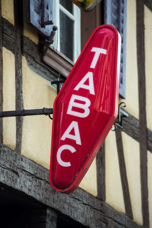closeup of red tabacco sign with french text tabac, the traduction in english of tobacco Redactioneel