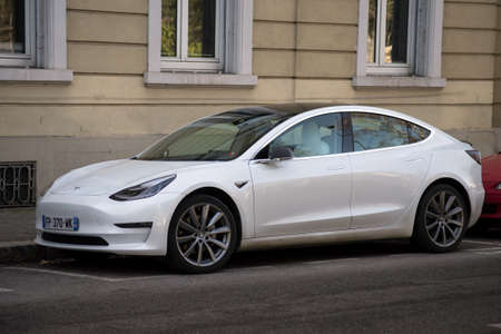 Mulhouse - France - 25 February 2021 - Front view of white tesla car parked in the street, Tesla is the famous brand of electric cars
