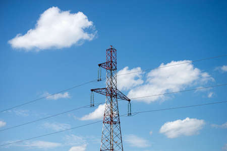 vuew of high voltage tower on blus cloudy sky background