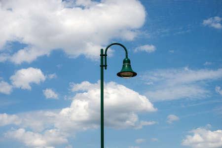Closeup of modern street lamp on blue cloudy sky background