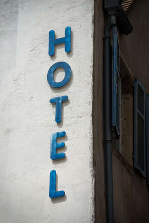 Closeup of Hotel sign in building facade in the street Stock Photo