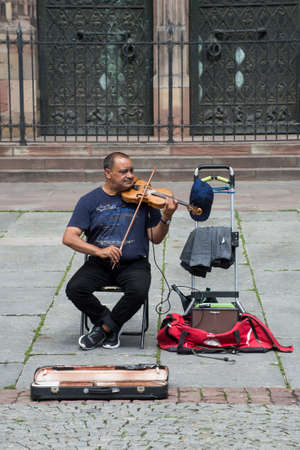 Strasbourg - France - 11 Jully 2021 - Portrait of violinist  playing in the street Editorial