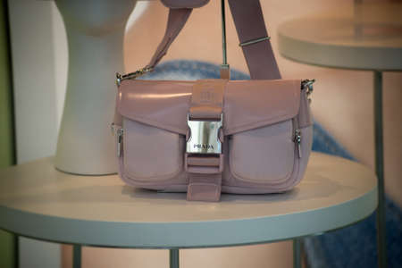 Strasbourg - France - 11 Jully 2021 - Closeup of pink color handbag by Prada in a luxury fashion store showroom