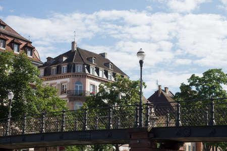 view of metallic pedestrian bridge on the Il river in Strasbourg - France