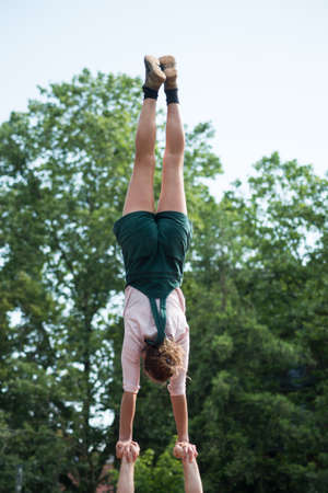 Portrait on back view of girl balancing during the street scene festival Stock Photo