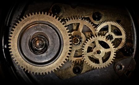 reloj antiguo: ruedas dentadas en viejo reloj Foto de archivo