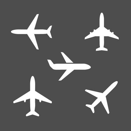 airport cartoon: Five different airplane silhouette icons viewed from the side   on takeoff  from below and flying midair on a grey background conceptual of travel and vacations Illustration