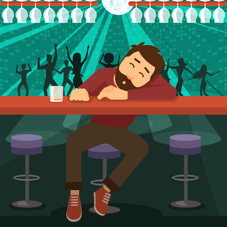 Alcoholic drunk man asleep at the bar in the night club