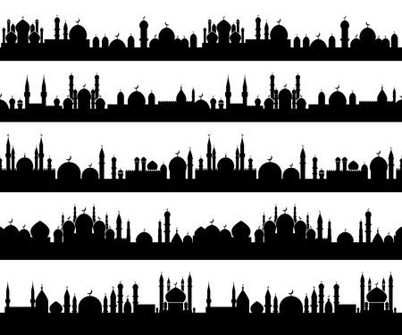 伊斯兰城市景观的剪影清真寺和尖塔与新月的顶部
