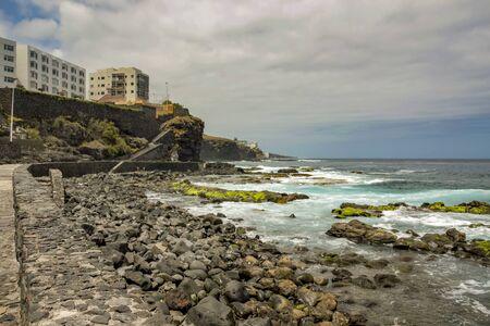 Coast line of Bajamar. Surf and big round stones. Canary Island, Tenerife, Spain Фото со стока