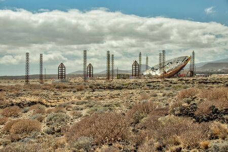 Huge parabolic Dish with Solar Panels. Abandoned construction for producing enegy. Used for production of methanol and coal.. El Medano, Tenerife, Canary Islands.