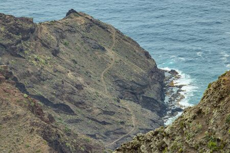 Aerial view of northeast of La Gomera Island. Beautiful rocky ocean coast with breaking waves. Playa De Caleta, La Gomera, Canary islands, Spain