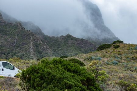 Parque Natural Majona. Northeastern part of La Gomera Island. Old volcanic mountains covered by green grass, thickets of relic laurels and heather on steep slopes. Canary Islands, Spain.
