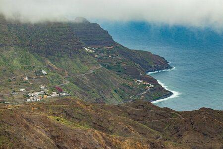 Aerial view of northeast of La Gomera Island. Beautiful rocky ocean coast with breaking waves. Playa de Hermigua, La Gomera, Canary islands, Spain.