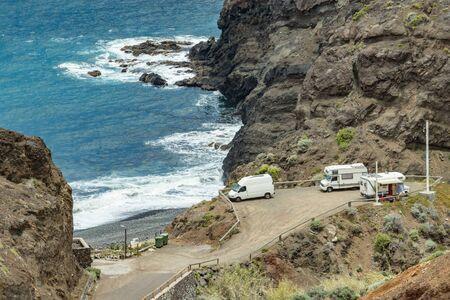 View of northeast of La Gomera Island. Beautiful rocky ocean coast with breaking waves. Playa De Caleta, La Gomera, Canary islands, Spain.