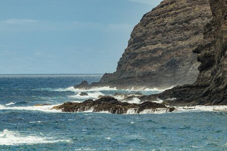 Playa De Caleta, northeast of La Gomera Island. Beautiful rocky ocean coast with breaking waves. , Canary islands, Spain.
