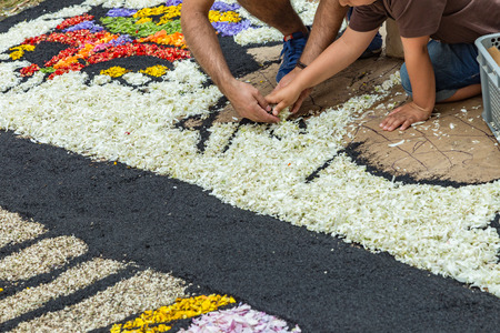 la Orotava, Tenerife, Spain - June 27, 2019. Beautiful flower carpets in La Orotava during Corpus Christi. Colorful Flower petals, twigs, needles, seeds.. Warm summer evening and joyful visitors. Editorial