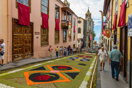 la Orotava, Tenerife, Spain - June 27, 2019. Beautiful flower carpets in La Orotava during Corpus Christi. Famous religious event and competition of folk art.. Warm summer evening and joyful visitors.