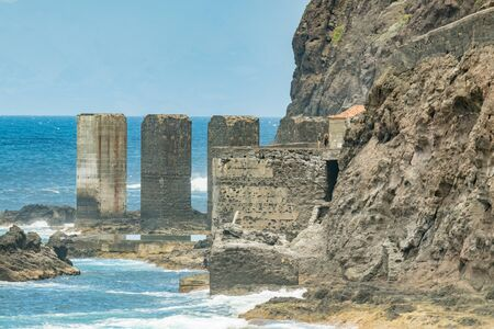 Santa Catalina beach. Huge concrete piers for davit and the ruins of the old Hermigua port used for export of bananas and other agricultural products. Telephoto lens. La Gomera, Canary Islands, Spain.