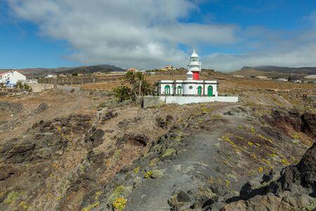 Lighthouse Faro de San Cristobal on Punta del Faro, located on a high rocky cliff in the vicinity of San Sebastian, the capital of the island of La Gomera, Canary Islands. Reklamní fotografie