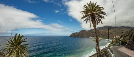 View of the island of Tenerife from Santa Catalina beach. Huge concrete piers for davit and the ruins of the old Hermigua port in the background. La Gomera, Canary Islands, Spain.