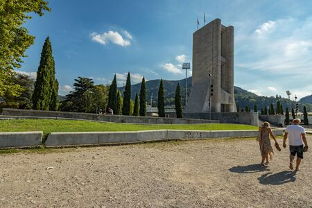 Como, ITALY - August 4, 2019: Local people and tourists on the promenade along the lake in the center of beautiful Italian Como city. Warm sunny summer day in very popular holiday destination