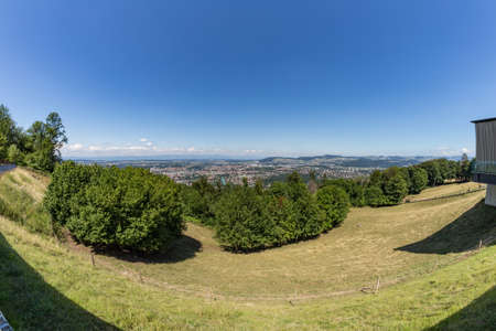 Aerial view of the swiss Capital from the top of Gurten Mountain Park. Pleasant sunny summer day. Super wide angle panorama.