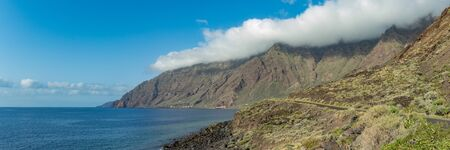 Wide angle panorama. Natural beach Las Playas. Very popular for tourists and locals. There you can look at the Roque de Bonanza is one of the symbols of El Hierro island and its natives. El Hierro.