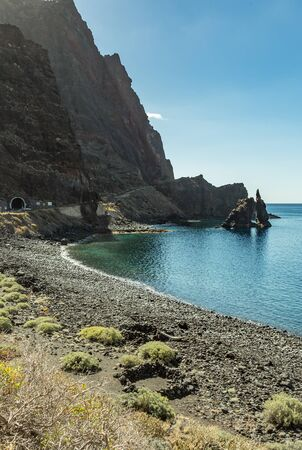 Roque de Bonanza is one of the symbols of El Hierro island and its natives. Huge Rock sticking out of the water on the las Almorranas beach. El Hierro, Canary islands Spain. 版權商用圖片