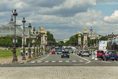 Paris, France - June 25, 2016: Beautiful Alexandre III Bridge. This bridge is absolutely stunning with very fine statues on this bridge, One of my most favourite bridges in the world. French history. Editorial