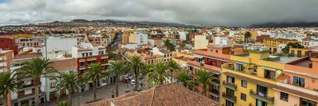The top of highest church tower. Wide angle panorama of the historic town of San Cristobal de La Laguna in Tenerife showing streets and tiled roofs of historic buildings and horizon in the background Reklamní fotografie
