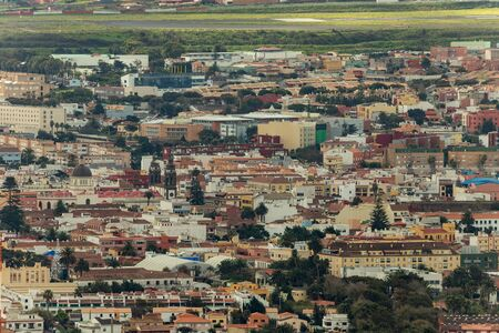 Aerial view, long focus lens shot of the historic town of San Cristobal de La Laguna in Tenerife. Mirador De Jardina. Streets and tiled roofs of historic buildings and towers of Cathedral.