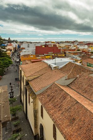 The top of highest church tower. Aerial view of the historic town of San Cristobal de La Laguna in Tenerife showing streets and tiled roofs of historic buildings with horizon in the background.