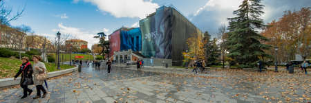 MADRID, SPAIN - DECEMBER 13, 2018: People in front of the Main entrance leading to the Prado Museum a major cultural landmark in Madrid. Super wide angle panorama. Redakční
