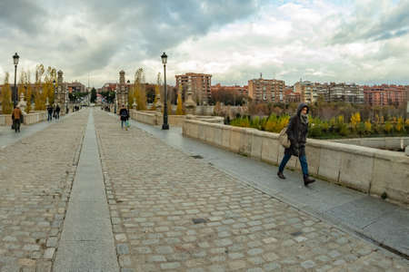 MADRID, SPAIN - DECEMBER 13, 2018: The Toledo bridge over Manzanares River downtown Madrid, Spain.