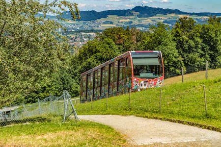 The Gurten funicular lets you to reach a paradise of green meadows and breathtaking views of the snowy caps of the Bernese Oberland region, the sparkling Aare river and the city of Bern, Switzerland.