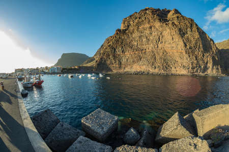 Huge concrete blocks in Port Valle Gran Rey at the atlantic ocean in La Gomera. A popular vacation spot for tourists and locals. , Canary islands, Spain