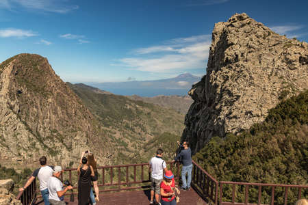 Los Roques in La Gomera island. A volcanic plug, also called a volcanic neck or lava neck, is a volcanic object created when magma hardens within a vent on an active volcano Redakční