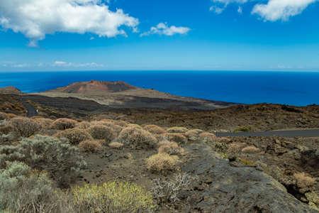 Volcanic landscape near Orchilla lighthouse. Southwest coast of the El Hierro island. Spain.