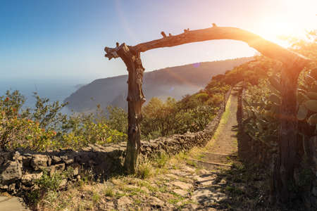 An old wooden archway in front of the beginning of an old rural trail. Aerial view of Las Playas. The wonderful landscape from Mirador de Isora, El Hierro island. Spain.