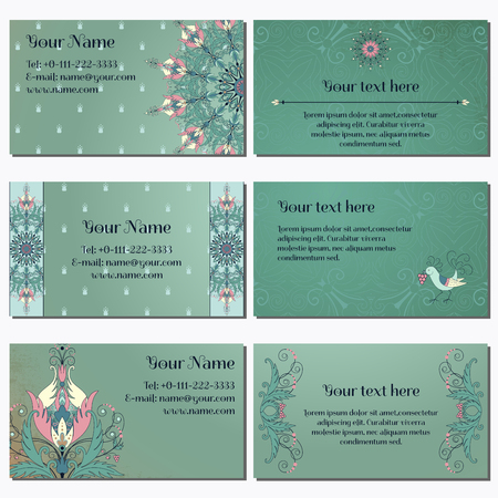 complied: Set of six horizontal business cards. Floral pattern on vintage background. Fantasy flowers with leaves and berries. Decorative bird pecks berries. Complied with the standard sizes.