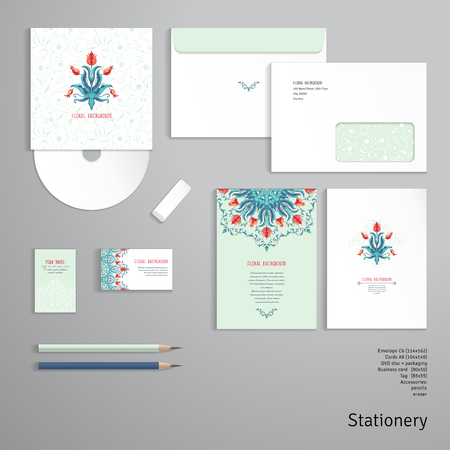 Vector templates. Envelope, cards, business cards, tags, disc with packaging, pencils, eraser. Floral element and ornament with leaves and curls. Round element of tulip flower.