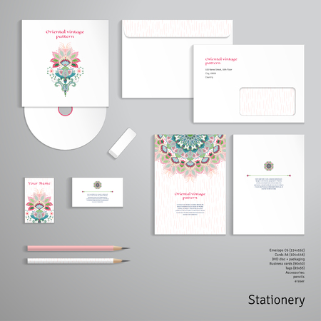Vector identity templates. Envelope, business card, cards, tag, disc with packaging, pencils. Bright oriental flowers and strokes on backdrop. Hand drawing.