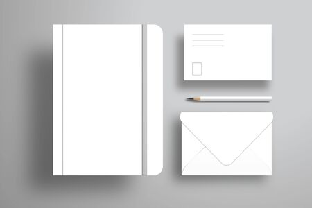 A white notebook with an elastic band, a postcard, an open envelope and a pencil. Realistic design for branding. Flat layout of white objects