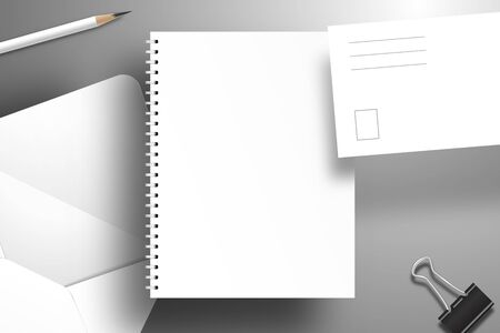 Blank white closed book or notebook with a spiral, postcasrd, binder, an open envelope and a pencil. Top view mockup template with shadow
