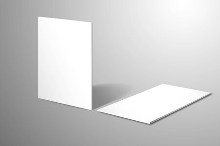 Two blank white business cards. One stands upright the second lies on the surface. Realistic branding template